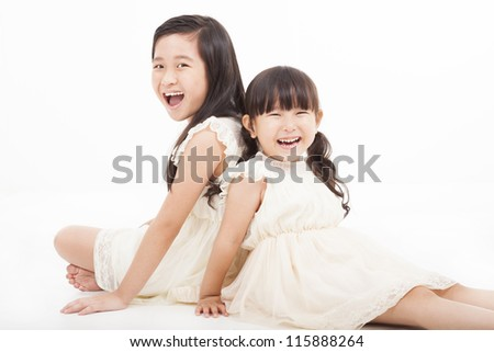 happy girls sitting on the white background