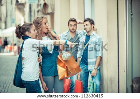Happy Girls With Bored Boys on Shopping