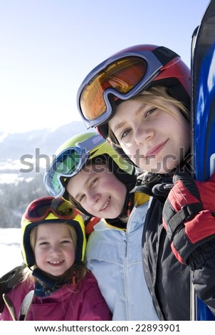 Happy girls with ski