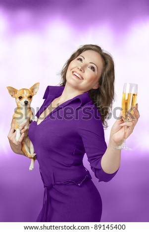 Happy glamour woman with champagne and small chihuahua dog