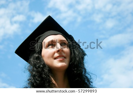 Happy graduate student against blue sky - stock photo