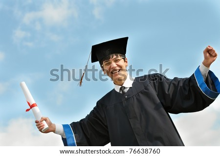 Happy graduate student in gown with diploma over blue sky