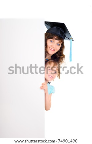 Happy graduate student-young mother with daughter behind the banner - stock photo