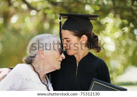 Happy graduate with grandmother celebrating graduation. Closeup, shallow DOF. - stock photo