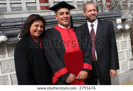 Happy graduate with his mother and father.