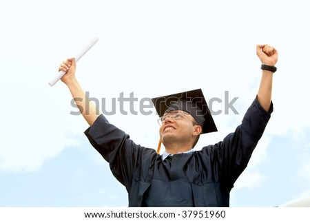 Happy graduated man in blue gown outdoors
