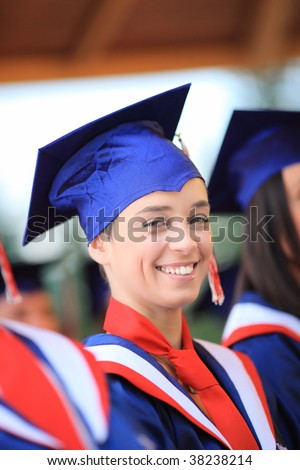 Happy graduating student wearing cap and gown
