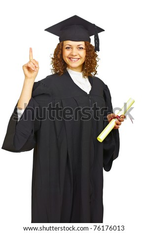 Happy graduation girl with diploma pointing up isolated - stock photo