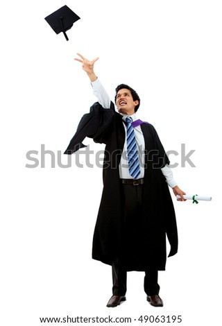 Happy graduation man throwing his mortarboard isolated over a white background