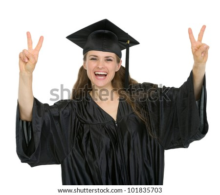 Happy graduation student showing victory gesture
