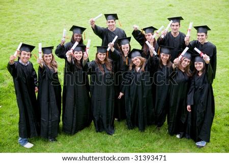 happy graduation students full of success outdoors