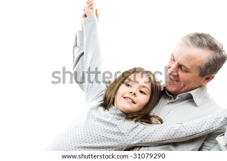 Happy grandfather and granddaughter
