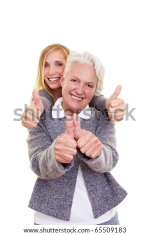 Happy grandma and her granddaughter holding their thumbs up