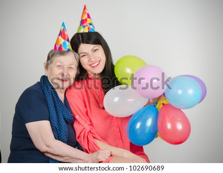 Happy grandmother and granddaughter - stock photo