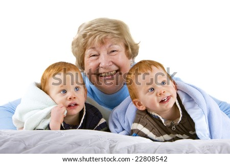 Happy grandmother with redheaded grandsons with blanket