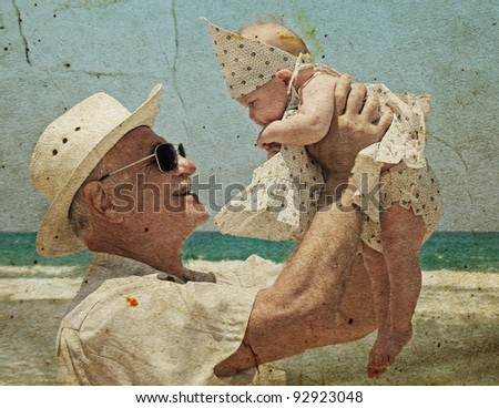 happy grandpa is holding a little granddaughter. Background - the sea.  Photo in old image style.