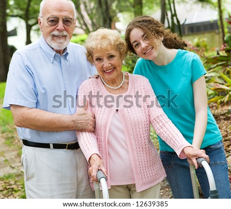 Happy grandparents enjoying time with their teen granddaughter.