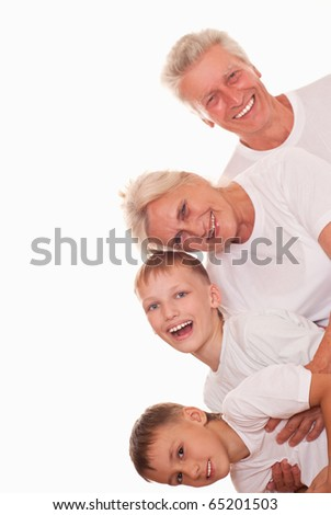 happy grandparents with grangchildren on a white