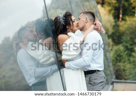 Happy groom is is tenderly kissing beautiful bride. Sensual romantic moment. Enjoy moment of happiness and having fun. Concept about passion and love. #1466730179