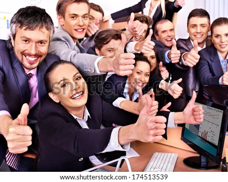 stock-photo-happy-group-business-people-thumb-up-in-office-174513539.jpg