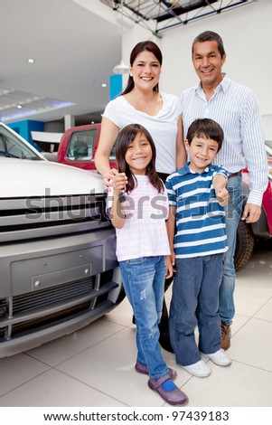 Happy group holding the keys of their new family car