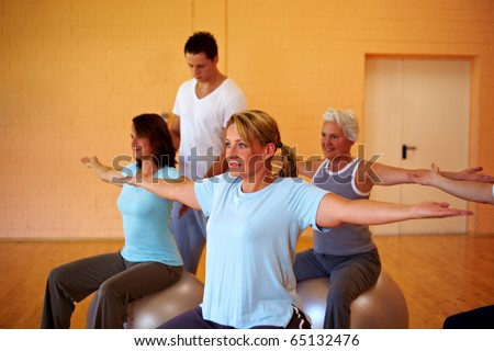 Happy group in a gym doing back exercises