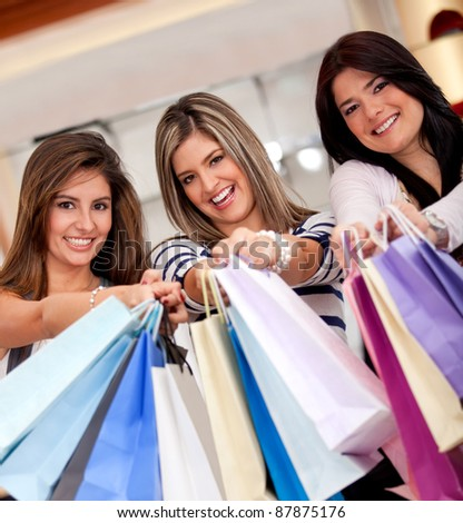 Happy group of beautiful shopping women smiling