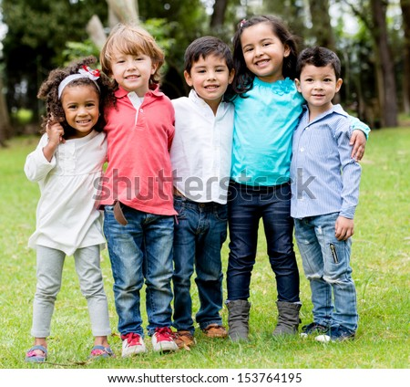 Happy group of children together at the park