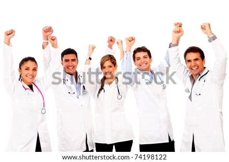 Happy group of doctors with arms up - isolated over white