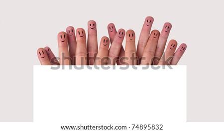 Happy group of finger smileys (holding whiteboard)