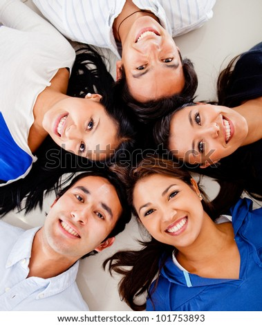 Happy group of friends lying on the floor together