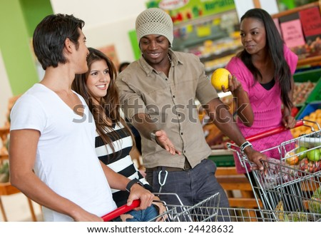happy group of friends smiling at the supermarket