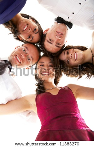 happy group of friends smiling with their heads together ready to party isolated over a white background