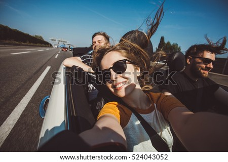 Happy group of friends taking selfie when road trip in convertible car. Cheerful students having fun when travel in Europe. #524043052