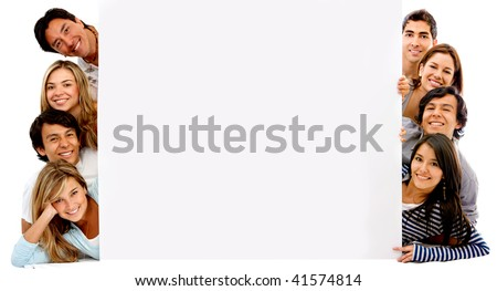 happy group of friends with a banner ad on the floor isolated over white