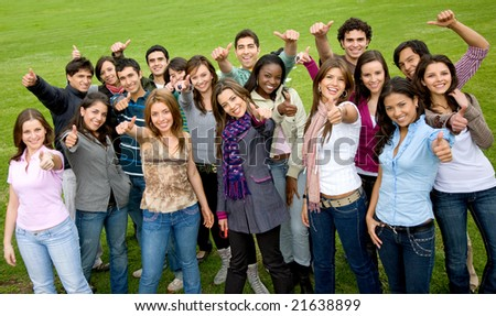 happy group of friends with thumbs up outdoors in a park