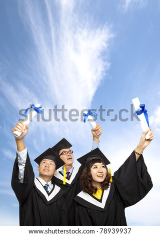 happy group of  graduation students holding their diploma - stock photo