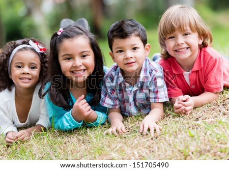 Happy group of kids playing at the park