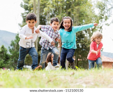 Shutterstock Happy group of kids playing at the park