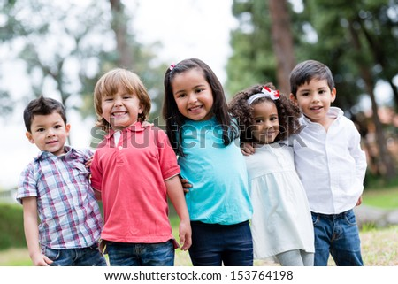 Happy group of kids smiling at the park