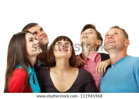 Happy group of people happy looking up. over white background