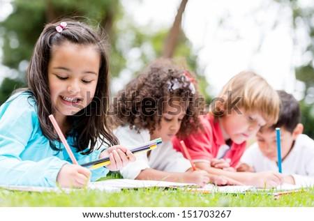 Happy group of school kids having fun