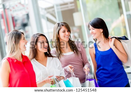 Happy group of shopping girls at the mall