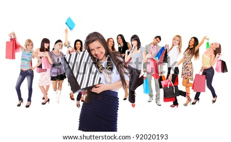 Happy group of shopping people holding bags - isolated over white