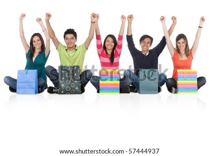 Happy group of shopping people - isolated over a white background