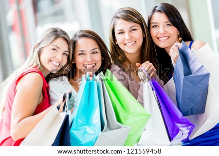 Happy group of shopping women holding bags