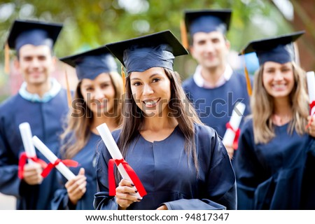Happy group of students in their graduation smiling