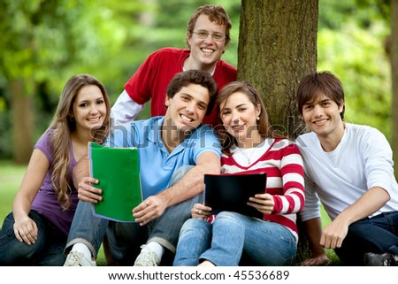 Happy group of students outdoors with notebooks