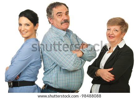 Happy group of three business people standing with arms folded in a line isolated on white background