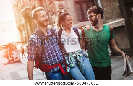 Happy group of tourists traveling and sightseeing together